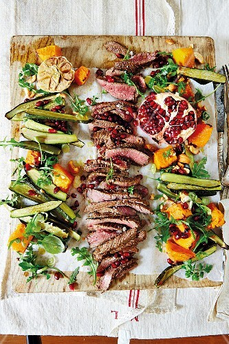 Ostrich fillet with a salad of baked pumpkin and courgettes