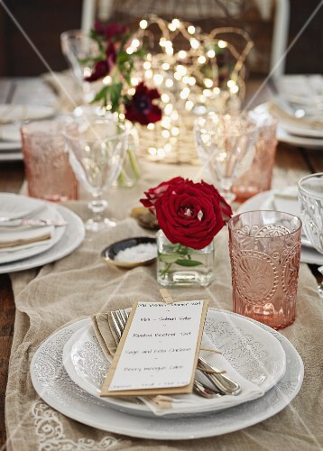 A festively laid table with rose decorations