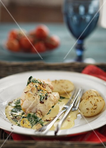 Monkfish medallions with herb potatoes