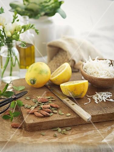 An arrangement of lemons, almonds and pumpkin seeds