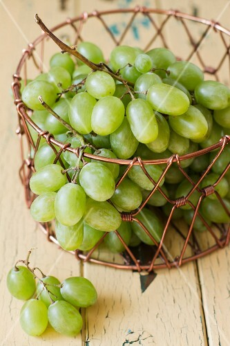Green grapes in a wire basket