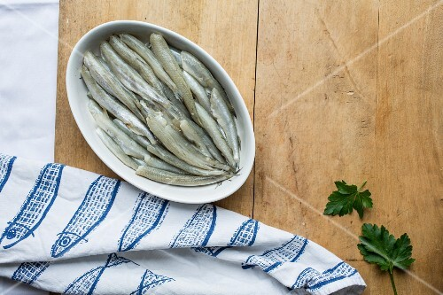 Fresh smelts in a ceramic bowl
