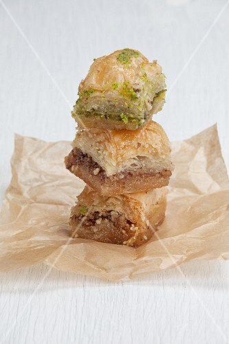 A stack of baklava on parchment paper