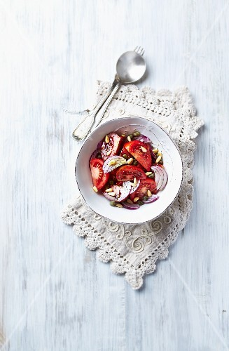 Mediterranean-style tomato salad with capers, onions and pine nuts