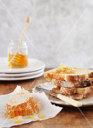 Slices of toast with honey comb and honey