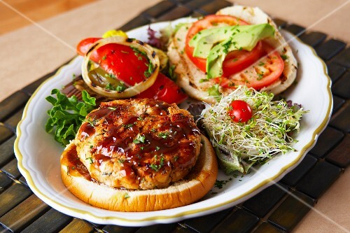 Salmon burger with pickled peppers and bean sprouts