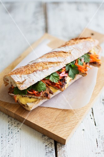 Banh Mi sandwich with pork, coriander, pickled carrots radishes and mayonnaise (Vietnam)