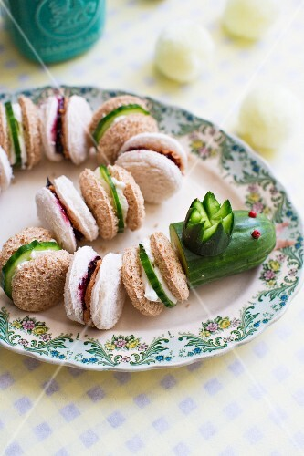 A sandwich snake with peanut butter and jelly sandwiches, and cucumber and cream cheese sandwiches