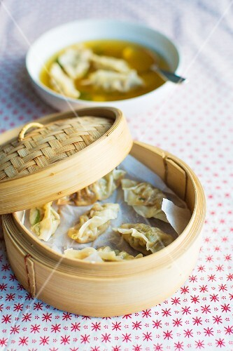 Clear ginger broth with steamed dumplings (China)