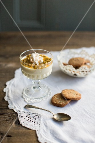 Passion fruit panna cotta with meringue, brittle and pecan nut biscuits