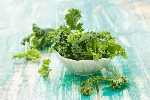 A bowl of young kale leaves
