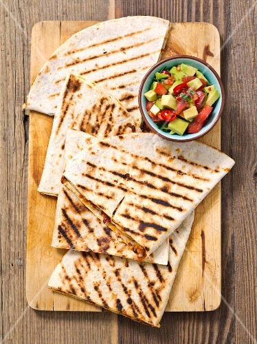 Quesadillas with a kidney bean filling and avocado and tomato salsa