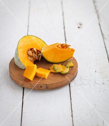 Sliced pumpkin on a wooden plate