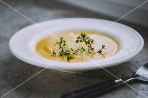 Cream of vegetables soup with lentils, carrots and Parmesan