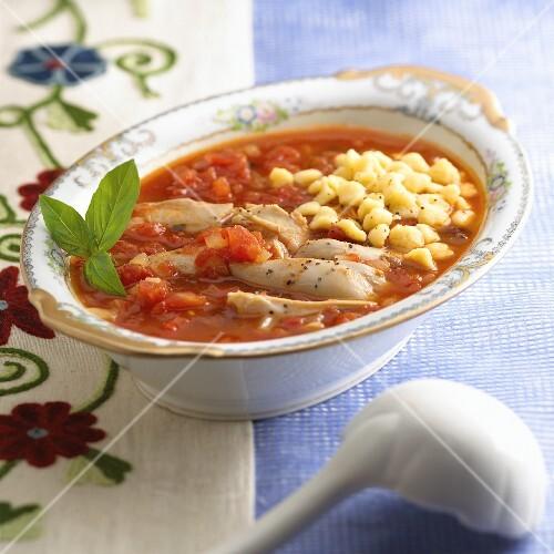 Chicken in tomato sauce with corn dumplings