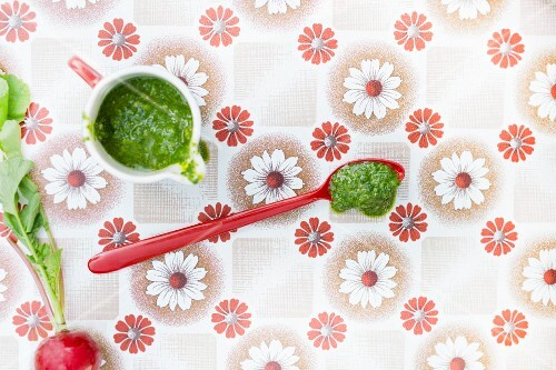 Homemade radish pesto on a vintage surface