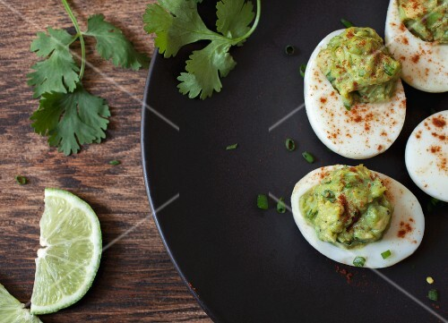 Devilled eggs with avocado cream (seen from above)
