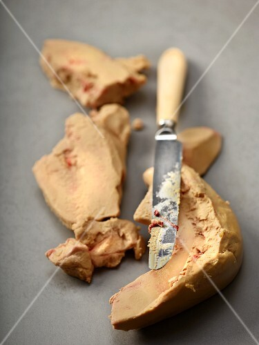 Tendons being removed from goose liver