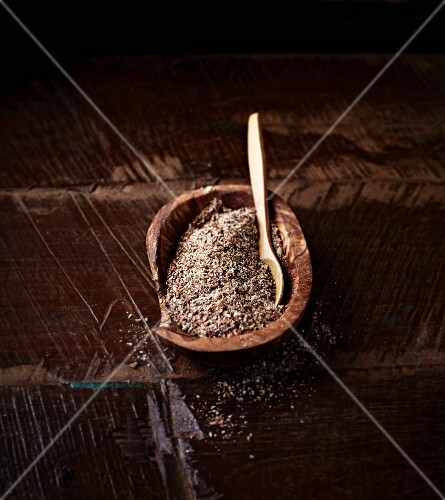 Ground flax seeds in a wooden dish