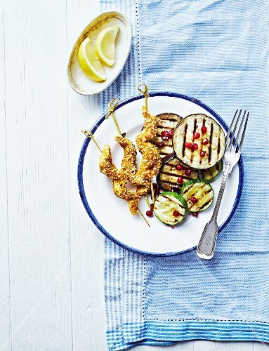 Sate skewers with grilled aubergines and courgettes