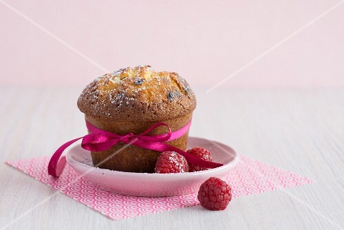A white chocolate muffin with raspberries