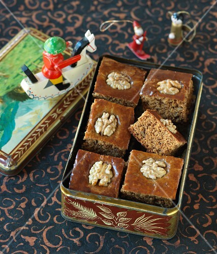 Gingerbread cake with walnuts in a tin