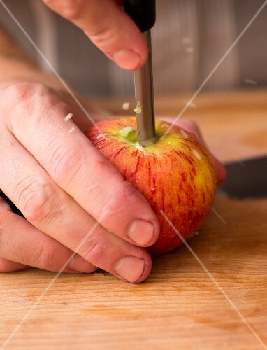 An apple being cored