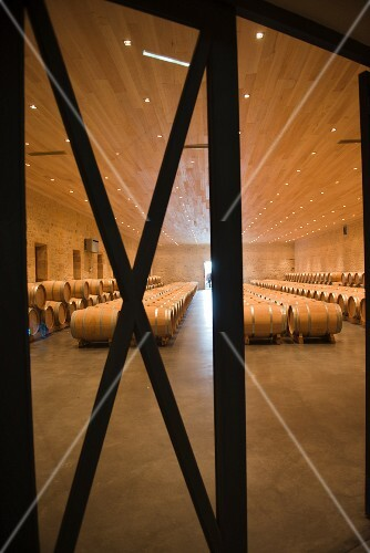 A view of barrique barrels in the wine cellar at Chateau Fourcas Hosten (Bordeaux, France)