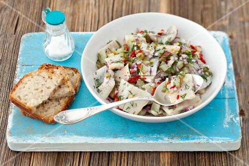 Herring salad with gherkins, chilli, onions and dill served with bread