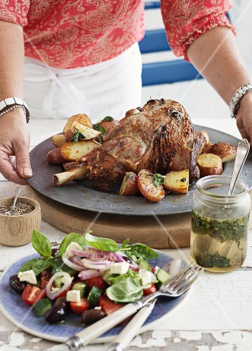 Roast lamb with potatoes and salad