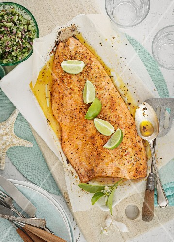 Oven roasted salmon fillet with pepper and limes