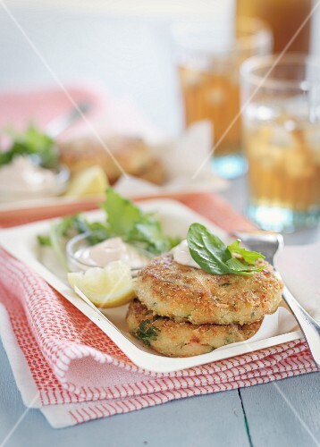 Salmon fritters with lemon and a dip