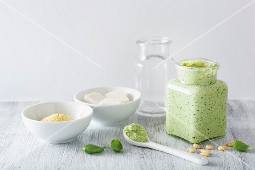 Vegan basil pesto with ingredients: tofu, yeast, pine nuts and basil