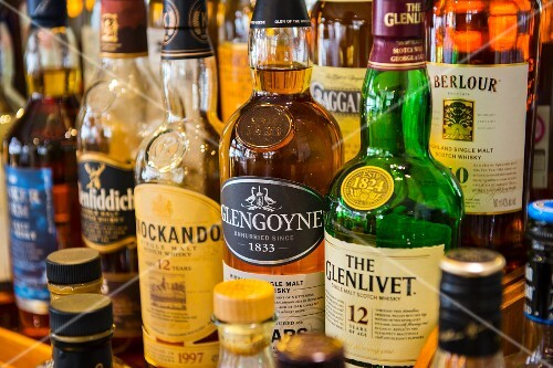 Various bottles of whiskey in a bar