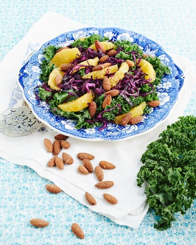 Kale salad with oranges and salted almonds