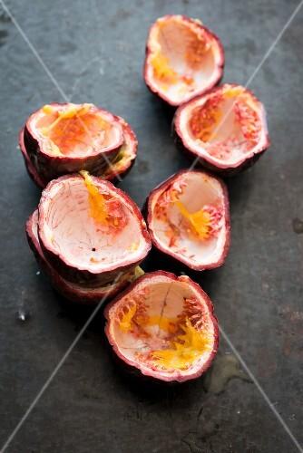 Scrapped out passion fruit halves
