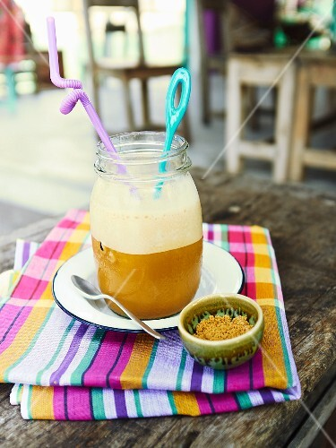 A coffee frappe on a restaurant table