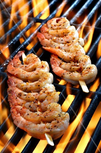 Prawn skewers on a grill (close up)