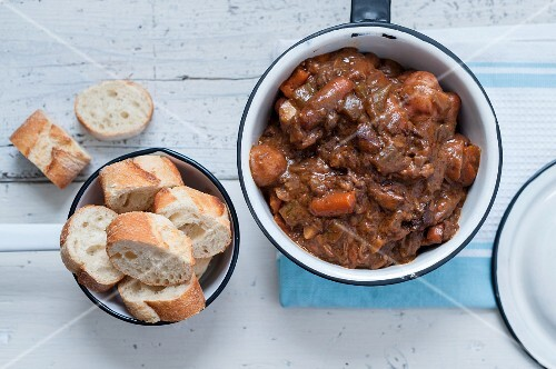 Beef goulash with carrots served with sliced baguette