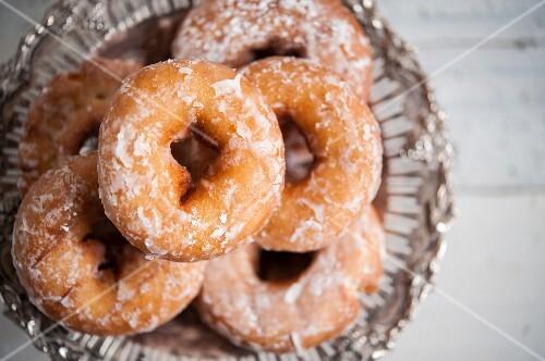 Sugar-glazed doughnuts in a wire basket