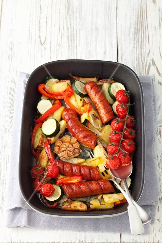 Sausage with potatoes, courgettes, cherry tomatoes and onions