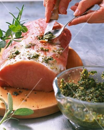 Herb roast pork being made