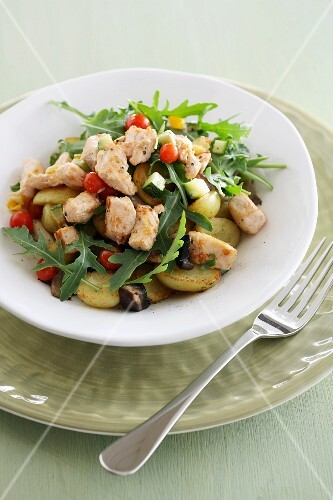 Salad with fried potatoes and diced salmon