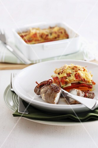 Vegetable gratin with beef roulade