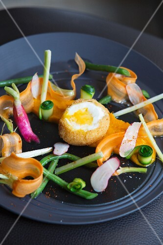 A fried egg with vegetables