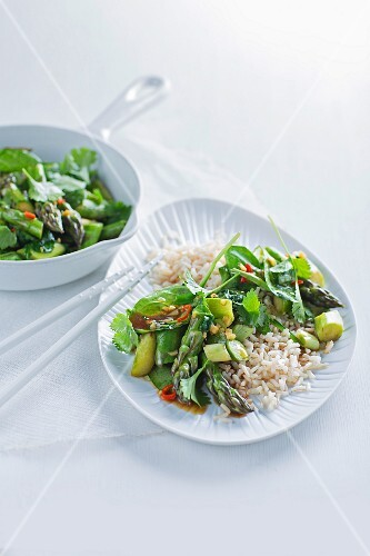 Asparagus and spinach medley on a bed of rice