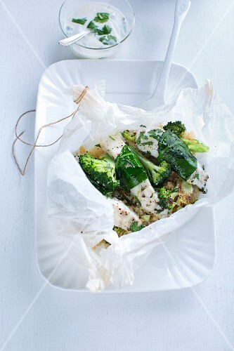 A fish parcel with broccoli and herb yoghurt