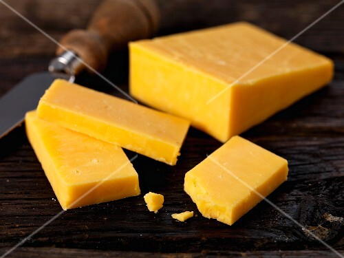 Double Gloucester cheese with a knife