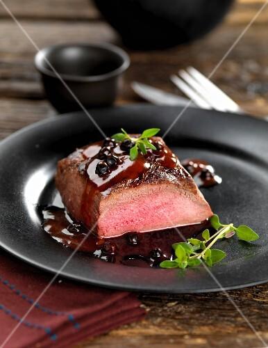 Venison steak with a juniper berry sauce