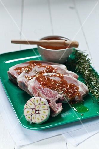Pork chops with a mustard marinade, fresh garlic and rosemary
